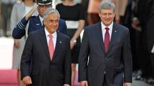Chilean President Sebastian Pinera welcomes Prime Minister Stephen Harper to the government palace in Santiago on April 16, 2012. (IVAN ALVARADO/REUTERS)