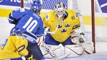 Finland's Joelæ Armia scores on Team Sweden goaltender Johanæ Gustafsson in the semi-final game in Calgary. (Nathan Denette/The Canadian Press/Nathan Denette/The Canadian Press)