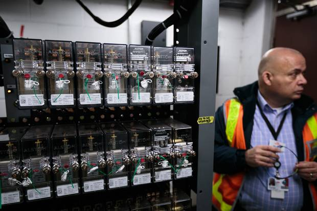 Mike Palmer, the TTC's chief operating officer, is shown near some of the new signalling equipment.