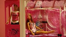 Barbie dolls are displayed inside a showroom at a Mattel office in Hong Kong January 12, 2010. (BOBBY YIP/REUTERS)