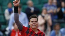 Canada's Milos Raonic celebrates winning the fourth round match of the French Open tennis tournament against Spain's Marcel Granollers at the Roland Garros stadium, in Paris on June 1. (Darko Vojinovic/AP)