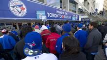 Fans line up before the Toronto Blue Jays and Cleveland Indians American League opening day baseball action in Toronto on Tuesday, April 2, 2013. (CP)