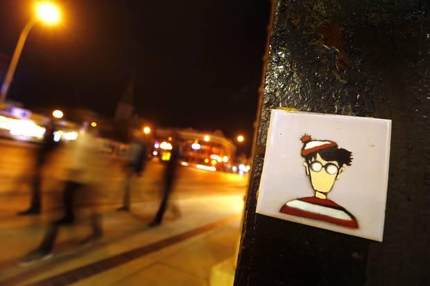 Winnipeg Waldo pastes doodles of the cartoon character around the city.