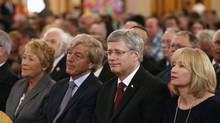 Canadian Prime Minister Stephen Harper (2nd R) and his wife Laureen Harper (R) sit with Quebec Premier Pauline Marois (L) and her husband Claude Blanchet during a memorial ceremony at the Sainte-Agnes church in Lac-Megantic, Quebec, July 27, 2013. (MATHIEU BELANGER/REUTERS)