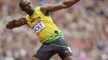 Jamaica's Usain Bolt gestures before competing in a men's 200-meter heat during the athletics in the Olympic Stadium at the 2012 Summer Olympics, London, Tuesday, Aug. 7, 2012. (Matt Slocum/AP)