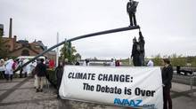 Avaaz campaigners gather on one side of a giant seesaw to give a visual image of today's IPCC report's key finding that there is a 95% scientific certainty that humans cause climate change, Sept. 27, 2013 in Stockholm. (Roger Vikstrom/AP Images for Avaaz)