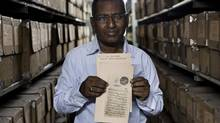 Dr. Mohammed Irfann, 54, an archivist in the Oriental Records Division of the National Archives of India, holds up a document from the Inayat Jang Collection in the National Archives of India, at Janpath, New Delhi, India on 11th June 2012. The Inayat Jang Collection is a rich collection of Official Mughal Documents from the times of Emperor Aurangzeb (starting in 1658) to Emperor Shah Alam II (ending 1774) and documents the day-to-day accounts and revenue figures. (Suzanne Lee/Photo by Suzanne Lee)