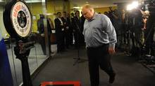Mayor Rob Ford heads for the scale during his weekly weigh in at city hall. While weighing in, two members of PETA ( People for the Ethical Treatment of Animals) showed up offering him a vegan option to help his weight loss program. (Fred Lum/The Globe and Mail/Fred Lum/The Globe and Mail)