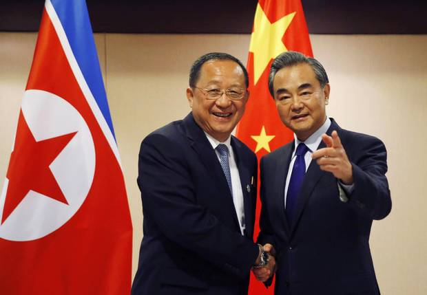 North Korean Foreign Minister Ri Yong Ho, left, is greeted by his Chinese counterpart Wang Yi prior to their bilateral meeting in the sidelines of the 50th ASEAN Foreign Ministers' Meeting and its Dialogue Partners Sunday, Aug. 6, 2017.