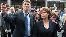 Vancouver Mayor Gregor Robertson and British Columbia Premier Christy Clark tour Granville St. in Vancouver on Thursday June 16, 2011. (Darryl Dyck/ The Canadian Press/Darryl Dyck/ The Canadian Press)