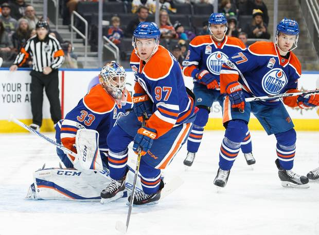 McDavid's rare combination of size and speed make him a dangerous weapon on the ice, but it's the captain's hockey IQ makes him a EDMONTON, AB - MARCH 10: Connor McDavid #97, goalie Cam Talbot #33, Andrej Sekera #2 and Oscar Klefbom #77 of the Edmonton Oilers defend the zone against the Pittsburgh Penguins on March 10, 2017 at Rogers Place in Edmonton, Alberta, Canada. (Photo by Codie McLachlan/Getty Images)