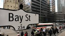 The Bay Street sign is pictured in the heart of the financial district as people walk by in Toronto, May 22, 2008. (MARK BLINCH/MARK BLINCH/REUTERS)