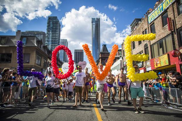 People march in the Toronto Pride Parade, Sunday, July 3, 2016.