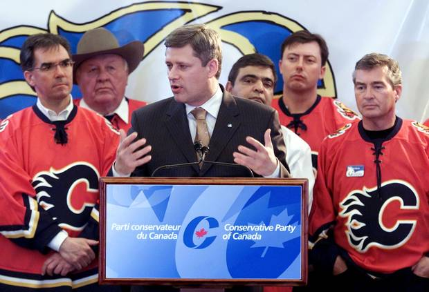 Mr. Prentice, left, stands by Conservative leader Stephen Harper's side at a rally in Calgary on May 28, 2004.