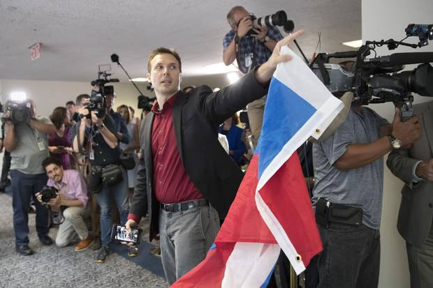 A protester holds a Russian flag in Washington on July 24, 2017, after yelling at Mr. Kushner, who was leaving Capitol Hill after a closed-door interview with Senate intelligence committee investigators looking into Russia's election meddling.