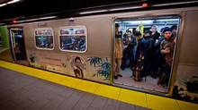 Commuters wait for the doors of a Canada Line train car to close before leaving the Oakridge-41st Avenue Station at the end of the work day in Vancouver, B.C., on Wednesday April 16, 2014. (DARRYL DYCK/THE GLOBE AND MAIL)