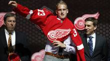 Anthony Mantha tries on a Detroit Red Wings jersey after being selected by the Red Wings as the 20th overall pick in the 2013 National Hockey league (NHL) draft in Newark, New Jersey, June 30, 2013. (Reuters)