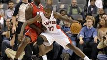 Atlanta Hawks' forward Ivan Johnson defends against Toronto Raptors' forward Ed Davis (R) during the second half of their NBA game in Toronto January 31, 2012. (MIKE CASSESE/REUTERS)
