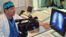 Dr. Paolo Zamboni describes the scan of a patient for CTV W5's camera.