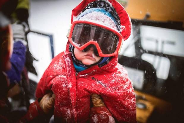 Raffi Treadway rides in the back of a snowcat at Troll Resort.