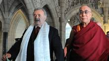 Senator Consiglio Di Nino escorts the Dalai Lama around Parliament Hill in Ottawa on Friday. (Sean Kilpatrick/The Canadian Press)