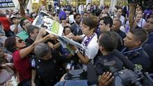 Brazilian soccer star Kaka signs autographs as he is surrounded by fans at Orlando International Airport (John Raoux/AP)