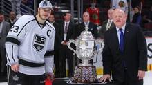 Los Angeles Kings right wing Dustin Brown is presented with the Clarence S. Campbell Bowl by NHL deputy commissioner Bill Daly after defeating the Chicago Blackhawks in Game 7 of the Western Conference Final of the 2014 Stanley Cup Playoffs at United Center. (USA TODAY Sports)