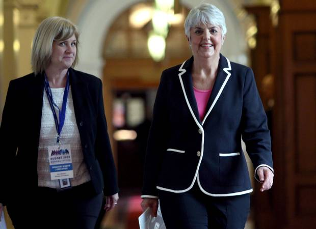 B.C. Finance Minister Carole James (right) arrives at caucus with a ministry staff member before delivering the provincial budget on Feb. 20, 2018.