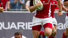 Canada's Phil Mackenzie, right, carries the ball down the field during the second half of play in an international rugby test match against Georgia in Burnaby, B.C., on Saturday June 23, 2012. Mackenzie is in good company at London Welsh these days, rubbing shoulders with players from England, France, New Zealand, Romania, Russia, Samoa, Scotland, Tonga and, of course, Wales. And the 25-year-old wing/centre from Oakville, Ont., is fitting in nicely in the top level of English rugby, having scored two tries already for the newly promoted club. (DARRYL DYCK/THE CANADIAN PRESS)