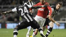 Manchester United's Park Ji-Sung (second right) is challenged by Newcastle United's Cheik Tiote (left) and Mike Williamson (right) during their English Premier League soccer match in Newcastle, northern England January 4, 2012. (NIGEL RODDIS/REUTERS)