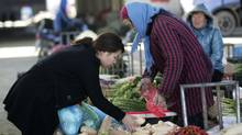 A woman buys vegetables at a market Friday Dec. 9, 2011 in Shanghai, China. China's chronically high inflation rate fell to a lower than expected 4.2 percent in November, allowing wider leeway for Beijing to ease credit to support growth. (AP)