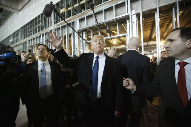 Republican presidential candidate Donald Trump enters the ballroom during a March tour of the Old Post Office Pavilion, soon to be a Trump International Hotel.