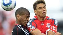 DC United defender Jordan Graye (L) collides with Toronto FC defender Adrian Cann while going for a ball during the second half of their MLS soccer game in Toronto September 11, 2010. (Reuters)