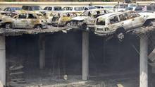 This photo released by the Kenya Presidency shows the collapsed upper car park of the Westgate Mall in Nairobi, Kenya Thursday, Sept. 26, 2013. (AP)