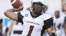 Ottawa Redblacks' quarterback Henry Burris throws a pass against the Montreal Aloutttes during first half CFL action in Montreal, Friday, June 20. (Graham Hughes/THE CANADIAN PRESS)
