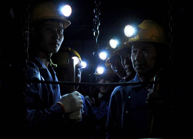 In this Tuesday, Sept. 8, 2009 photo released by China's Xinhua News Agency, rescue workers enter the Xinhua No. 4 coal mine in Xinhua district of Pingdingshan city, central China's Henan Province.