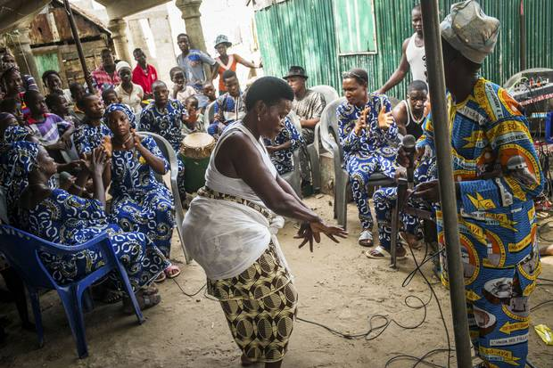 People sing and dance during a family-planning event in Ganvie.