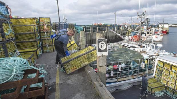 Fishermen prepare their boats for the lobster season in Woods Harbour, N.S., on Saturday, Nov. 26, 2016.