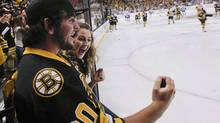 Boston Bruins fans cheer as the teams skate out onto the ice before Game 3 of the NHL hockey Stanley Cup Finals between the Vancouver Canucks and the Boston Bruins, Monday, June 6, 2011, in Boston. (AP Photo/Elise Amendola) (Elise Amendola/Getty Images)
