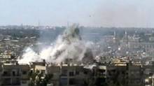 This video image taken from amateur video and broadcast by Bambuser/Homslive shows a series of devastating explosions rocking the central Syrian city of Homs, Syria, Monday, June 11, 2012. Live streaming video caught the devastation during one of the heaviest examples of violence since the uprisings began over a year ago. (Anonymous/AP)