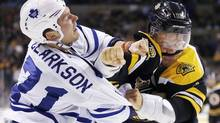 Toronto Maple Leafs' David Clarkson (71) and Boston Bruins' Jarome Iginla (12) fight in the second period of an NHL game in Boston, Saturday, Nov. 9, 2013. (Michael Dwyer/AP)