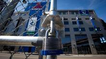 A padlock is seen on the gate of a parking lot outside Rogers Arena, the home of the Vancouver Canucks NHL hockey team, in Vancouver, B.C., on Sunday September 16, 2012. (Darryl Dyck/THE CANADIAN PRESS)