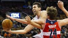 Italian forward Andrea Bargnani, left, is guaranteed $23.5-million (U.S.) over the next two seasons. (Nathan Denette/The Associated Press)