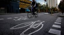 A cyclist uses the Hornby Street bike lane in downtown Vancouver. (DARRYL DYCK FOR THE GLOBE AND MAIL)