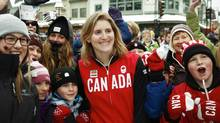 Hayley Wickenheiser is surrounded by fans during a send-off party for Canada's Sochi bound Olympic athletes in Banff, Alta. (Jeff McIntosh/The Canadian Press)