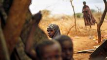 Somali refugees sit an an outdoor camp near Dadaab, Kenya on Aug. 9, 2011. (Jerome Delay/AP)
