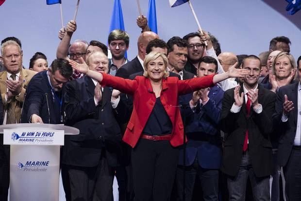 Far-right candidate for the presidential election Marine Le Pen gestures at the end of her campaign meeting in Paris, France, on April 17, 2017.