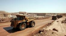 Trucks carry rocks containing uranium at the Arlit mine in Niger. (PIERRE VERDY/PIERRE VERDY/AFP/Getty Images)
