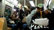 A woman eating spaghetti on a New York subway car caused a brawl. (YouTube/YouTube)