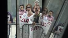 CUPE workers protest outside Metro Hall where city officials were holding a press conference to talk about the continuing CUPE strike in this July 15, 2009 file photo. Toronto's 23,000 inside workers could be off the job as early as 12:01 a.m. March 25, 2012. (Fred Lum/The Globe and Mail/Fred Lum/The Globe and Mail)